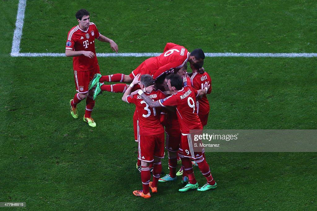 Bastian Schweinsteiger of Bayern Munich celebrates with team mates after scoring the first goal during the UEFA Champions League Round of 16 second leg match between FC Bayern Muenchen and Arsenal at Allianz Arena on March 11, 2014 in Munich, Germany.