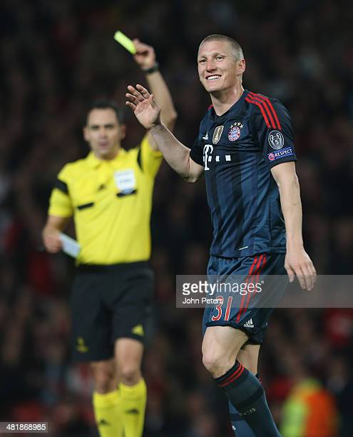Bastian Schweinsteiger of Bayern Munich reacts to being sent off during the UEFA Champions League quarterfinal first leg match between Manchester...