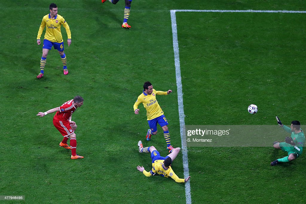 Bastian Schweinsteiger of Bayern Munich scores the first goal during the UEFA Champions League Round of 16 second leg match between FC Bayern Muenchen and Arsenal at Allianz Arena on March 11, 2014 in Munich, Germany.