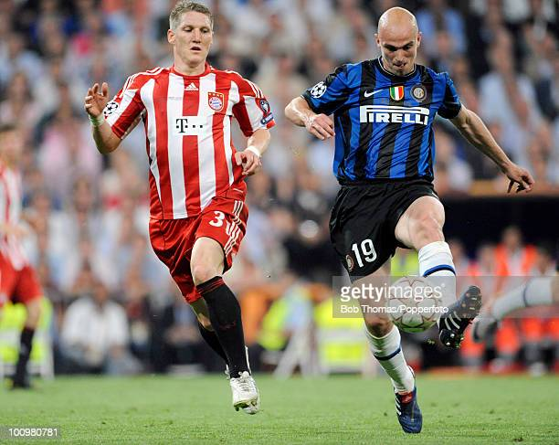 Bastian Schweinsteiger of Bayern Munich with Esteban Cambiasso of Inter Milan during the UEFA Champions League Final match between Bayern Munich and...