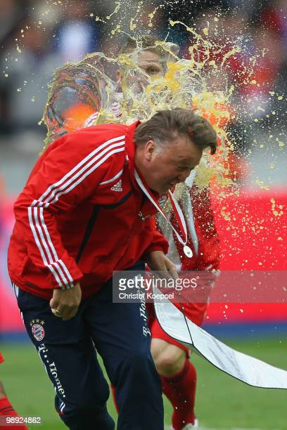 Bastian Schweinsteiger of Bayern pours a beer over head coach Louis van Gaal after after winning the German Champions trophy o during the Bundesliga...