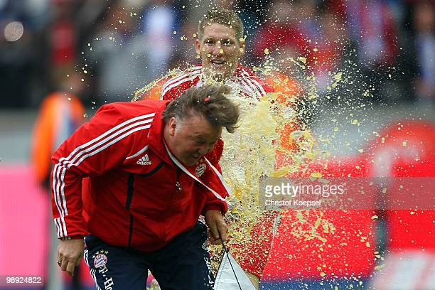 Bastian Schweinsteiger of Bayern pours drinks a beer over the head of head coach Louis van Gaal after after winning the German Champions trophy o...
