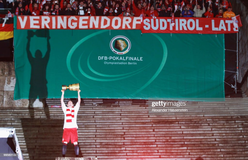 Bastian Schweinsteiger of Bayern presents the trophy after winning the DFB Cup final match between SV Werder Bremen and FC Bayern Muenchen at Olympic Stadium on May 15, 2010 in Berlin, Germany.