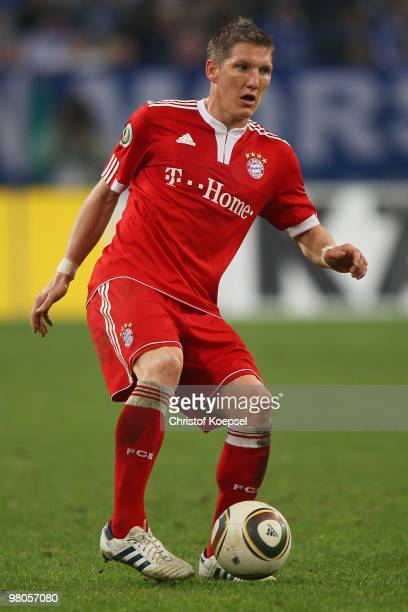 Bastian Schweinsteiger of Bayern runs with the ball during the DFB Cup semi final match between FC Schalke 04 and FC Bayern Muenchen at Veltins Arena...