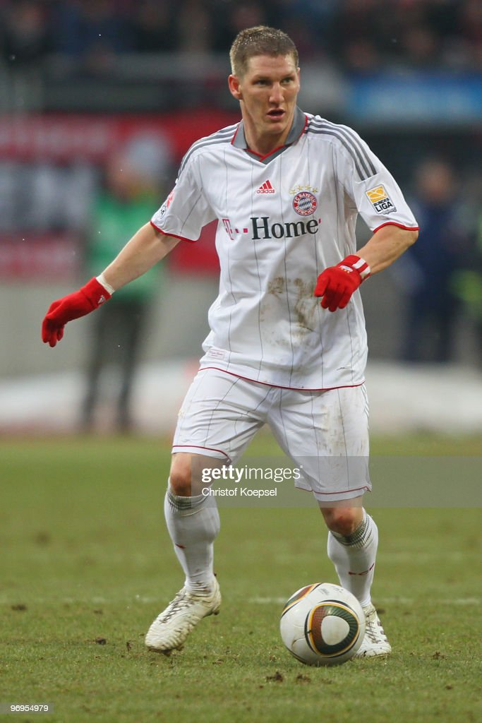 Bastian Schweinsteiger of Bayern runs with the ball during the Bundesliga match between 1. FC Nuernberg and FC Bayern Muenchen at Easy Credit Stadium on February 20, 2010 in Nuremberg, Germany.