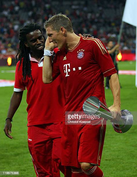 Bastian Schweinsteiger of Bayern speaks with Tinga of Porto Alegre after loosing 02 the Audi Cup final match between FC Bayern Muenchen and FC...