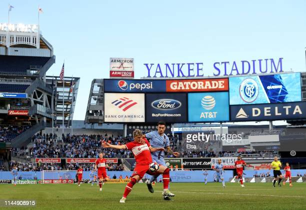 Bastian Schweinsteiger of Chicago Fire and Valentin Castellanos of New York City FC fight for the ball in the first half at Yankee Stadium on April...