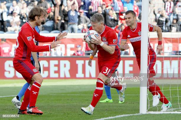 Bastian Schweinsteiger of Chicago Fire celebrates by kissing the ball after scoring a goal in the first half against the Montreal Impact during an...