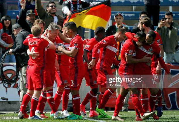 Bastian Schweinsteiger of Chicago Fire celebrates with teammates after scoring a goal against the Montreal Impact during first half at Toyota Park on...