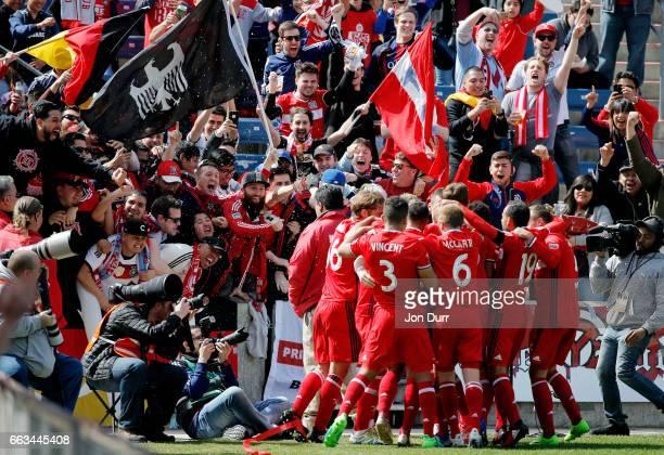 Bastian Schweinsteiger of Chicago Fire celebrates with teammates and fans after scoring a goal against the Montreal Impact during first half at...