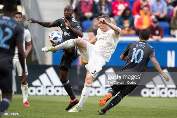 Bastian Schweinsteiger of Chicago Fire clears while challenged by Bradley WrightPhillips of New York Red Bulls during the New York Red Bulls Vs...