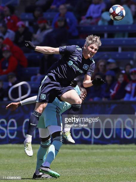Bastian Schweinsteiger of Chicago Fire leaps over Kei Kamara of Colorado Rapids for a header at SeatGeek Stadium on April 20 2019 in Bridgeview...