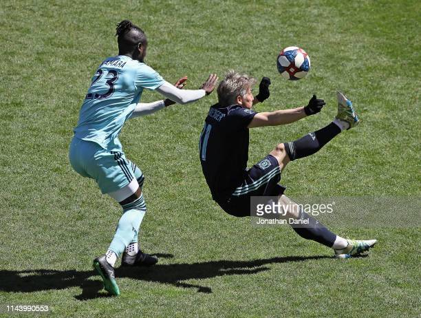 Bastian Schweinsteiger of Chicago Fire passes the ball over his head and Kei Kamara of Colorado Rapids at SeatGeek Stadium on April 20 2019 in...