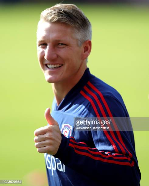 Bastian Schweinsteiger of Chicago Fire reacts during a Chicago Fire Training Session at Saebener Strasse training ground on August 26, 2018 in...