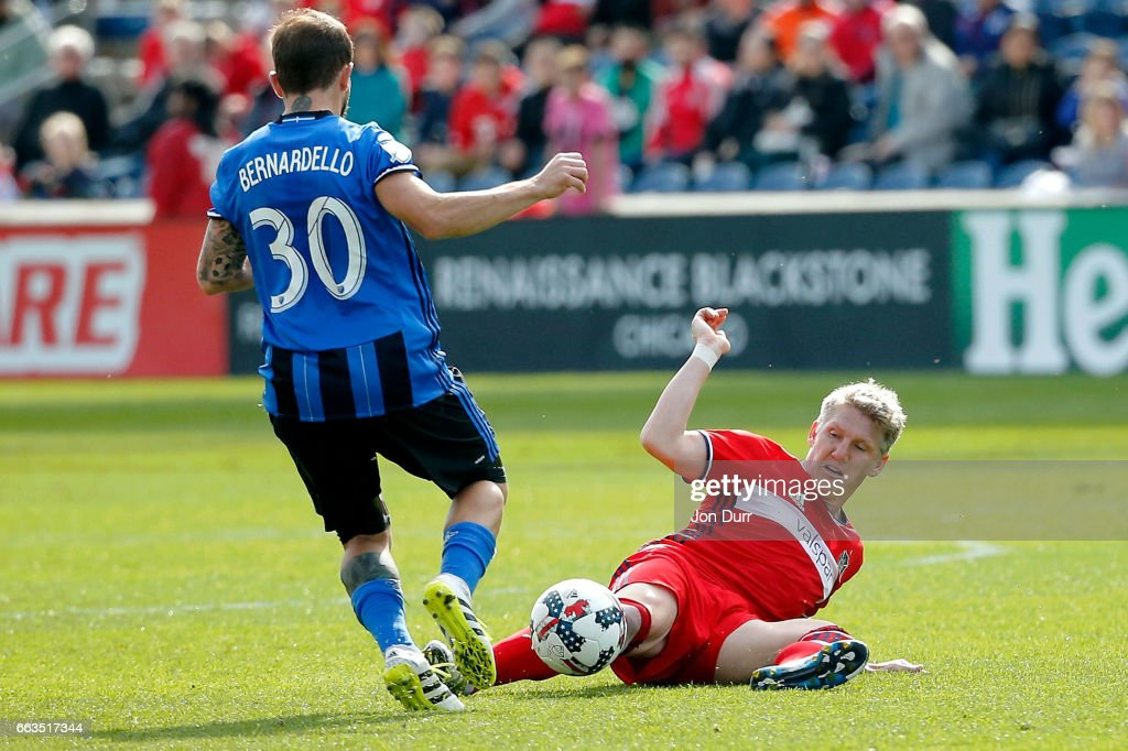 Bastian Schweinsteiger #31 of Chicago Fire stoppage time against Hernan Bernardello #30 of Montreal Impact during the second half at Toyota Park on April 1, 2017 in Bridgeview, Illinois. The match ended in a 2-2 draw.