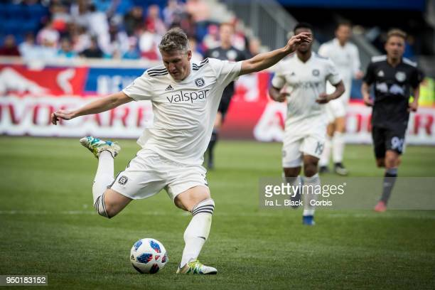 Bastian Schweinsteiger of Chicago Fire takes the shot on goal during the Major League Soccer match between Chicago Fire and New York Red Bulls at Red...