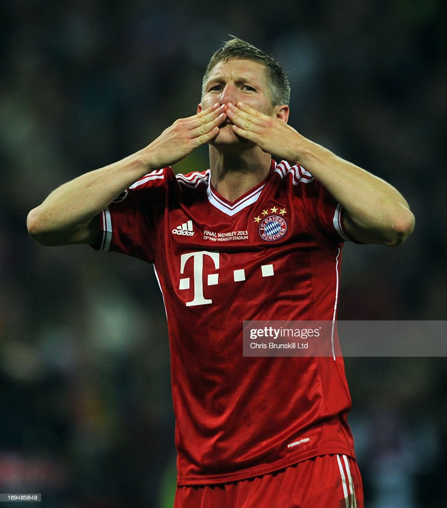Bastian Schweinsteiger of FC Bayern Muenchen blows kisses to the fans following the UEFA Champions League final match between Borussia Dortmund and FC Bayern Muenchen at Wembley Stadium on May 25, 2013 in London, England.