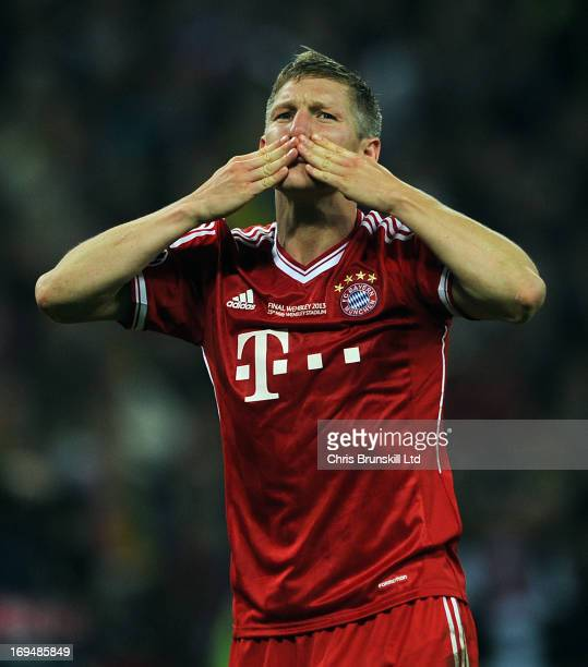 Bastian Schweinsteiger of FC Bayern Muenchen blows kisses to the fans following the UEFA Champions League final match between Borussia Dortmund and...