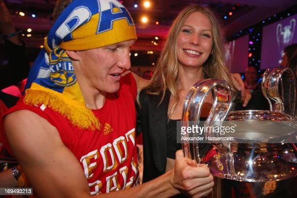 Bastian Schweinsteiger of FC Bayern Muenchen celebrates with Sarah Brandner on the Bayern Muenchen Champions League Finale banquet at Grosvenor House...