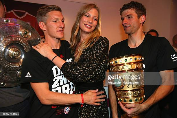 Bastian Schweinsteiger of FC Bayern Muenchen celebrates with Sarah Brandner and his team mate Thomas Mueller the FC Bayern Muenchen Champions party...