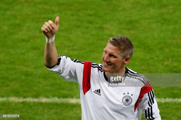 Bastian Schweinsteiger of Germany acknowledges the fans after defeating Algeria 21 during the 2014 FIFA World Cup Brazil Round of 16 match between...