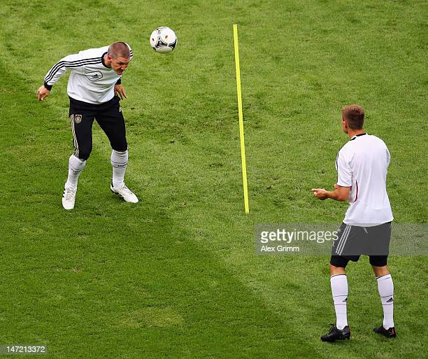 Bastian Schweinsteiger of Germany attends a training session ahead of their UEFA EURO 2012 semifinal match against Italy at the Municipal Stadium on...