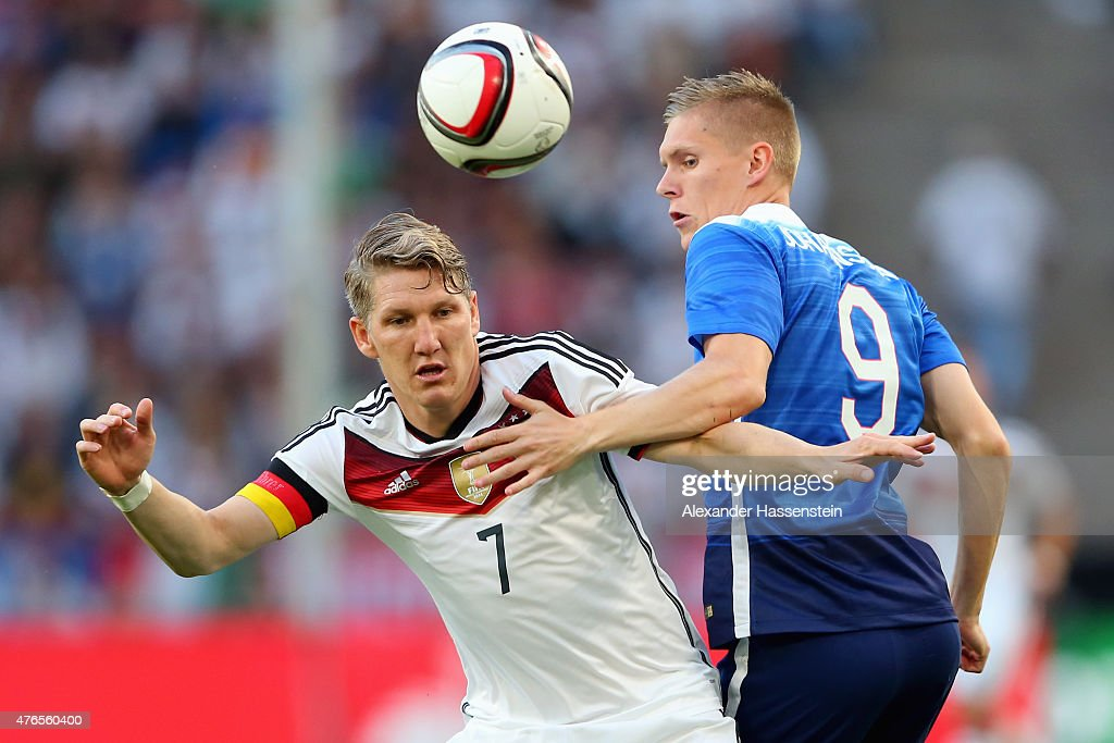 Bastian Schweinsteiger (L) of Germany battles for the ball with Aron Johannsson of USA during the international friendly match between Germany and USA at RheinEnergieStadion on June 10, 2015 in Cologne, Germany.