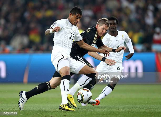 Bastian Schweinsteiger of Germany battles for the ball with Kevin Prince Boateng of Ghana during the 2010 FIFA World Cup South Africa Group D match...