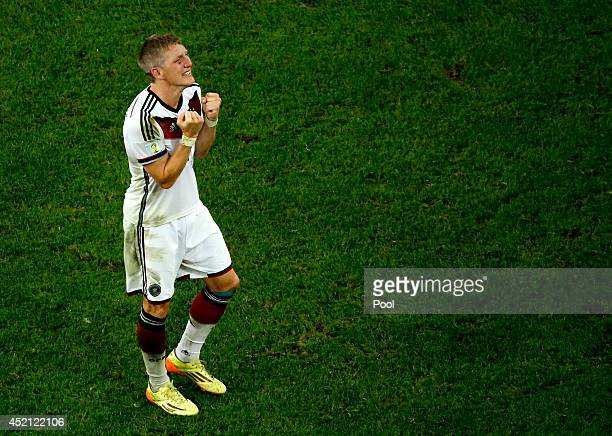 Bastian Schweinsteiger of Germany celebrates after defeating Argentina 1-0 in extra time during the 2014 FIFA World Cup Brazil Final match between...