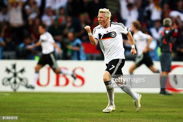 Bastian Schweinsteiger of Germany celebrates after his team mate Miroslav Klose scored the second goal during the UEFA EURO 2008 Quarter Final match...