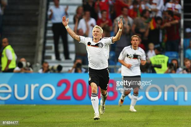 Bastian Schweinsteiger of Germany celebrates after scoring the opening goal during the UEFA EURO 2008 Quarter Final match between Portugal and...