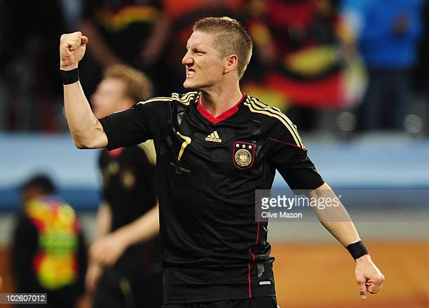 Bastian Schweinsteiger of Germany celebrates after victory and progress to the semi finals during the 2010 FIFA World Cup South Africa Quarter Final...