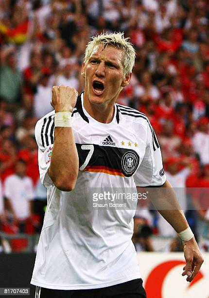 Bastian Schweinsteiger of Germany celebrates scoring Germany's opening goal during the UEFA EURO 2008 Semi Final match between Germany and Turkey at...