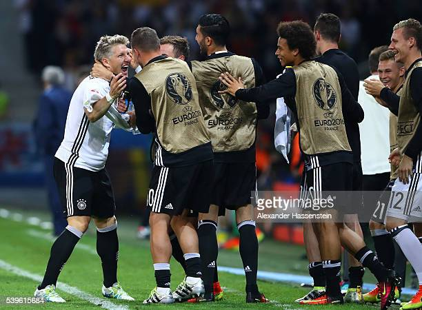 Bastian Schweinsteiger of Germany celebrates scoring his team's second goal with his team mates during the UEFA EURO 2016 Group C match between...