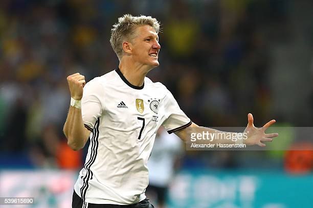 Bastian Schweinsteiger of Germany celebrates scoring his team's second goal during the UEFA EURO 2016 Group C match between Germany and Ukraine at...