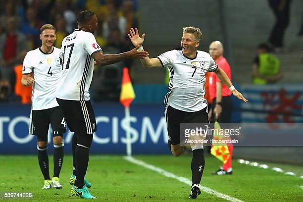 Bastian Schweinsteiger of Germany celebrates scoring his team's second goal with his team mate Jerome Boateng during the UEFA EURO 2016 Group C match...