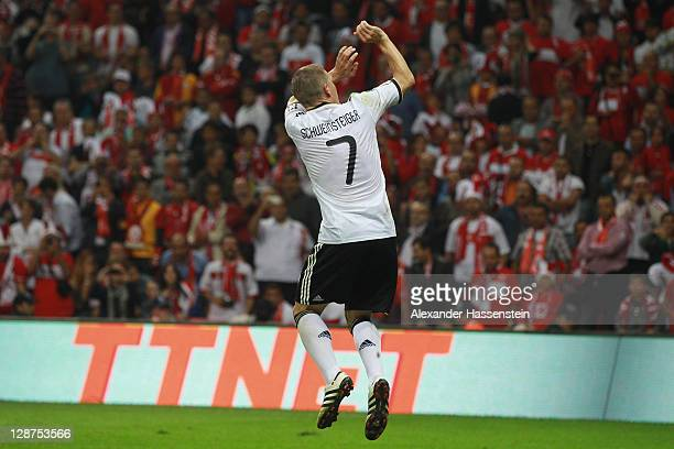 Bastian Schweinsteiger of Germany celebrates scoring the 3rd goal during the UEFA EURO 2012 Group A qualifying match between Turkey and Germany at...