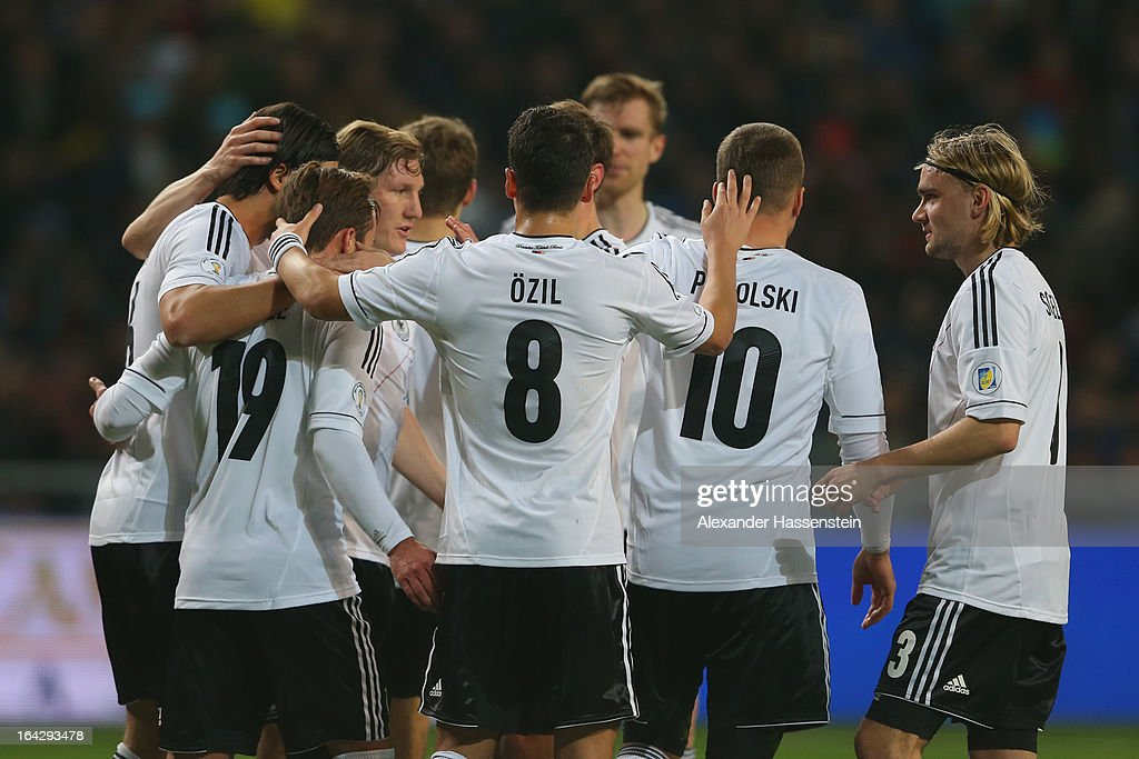 Bastian Schweinsteiger (3rd L) of Germany celebrates scoring the opening goal with his team mates during the FIFA 2014 World Cup qualifier group C match between Kazakhstan and Germany at Astana Arena on March 22, 2013 in Astana, Kazakhstan.
