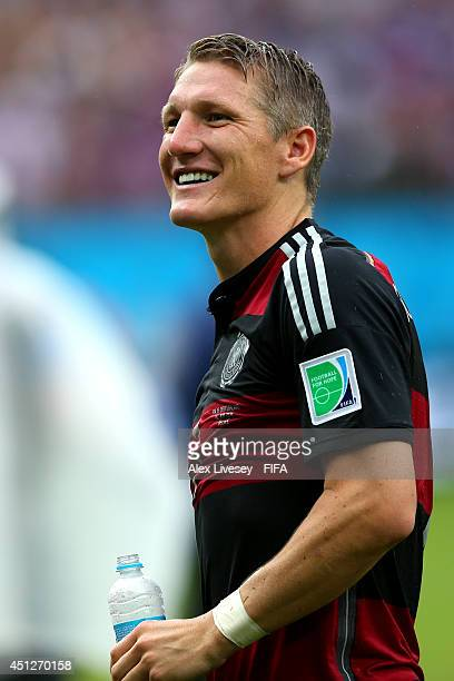 Bastian Schweinsteiger of Germany celebrates the 10 win after the 2014 FIFA World Cup Brazil Group G match between USA and Germany at Arena...