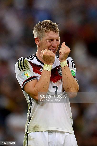Bastian Schweinsteiger of Germany celebrates the 10 win in the 2014 FIFA World Cup Brazil Final match between Germany and Argentina at Maracana on...