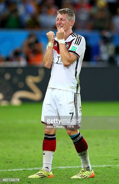 Bastian Schweinsteiger of Germany celebrates the 1-0 win in the 2014 FIFA World Cup Brazil Final match between Germany and Argentina at Maracana on...