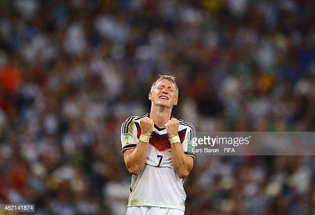 Bastian Schweinsteiger of Germany celebrates victory after the 2014 FIFA World Cup Brazil Final match between Germany and Argentina at Maracana on...