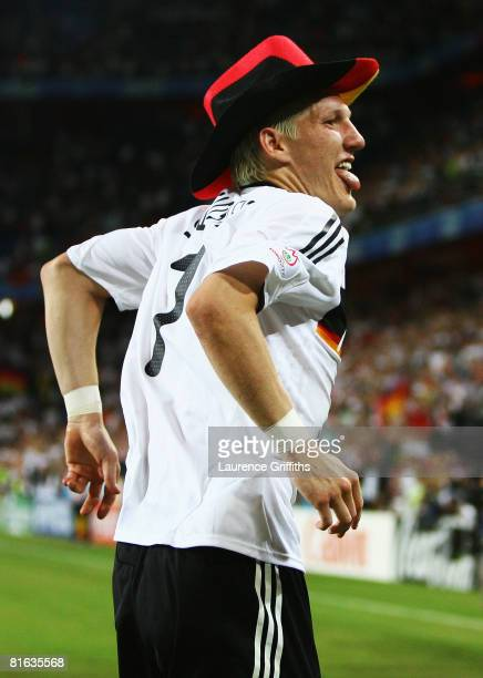 Bastian Schweinsteiger of Germany celebrates victory after the UEFA EURO 2008 Quarter Final match between Portugal and Germany at St. Jakob-Park on...