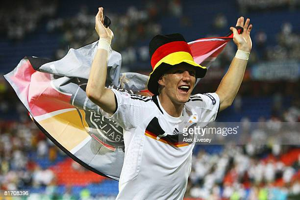 Bastian Schweinsteiger of Germany celebrates victory after the UEFA EURO 2008 Semi Final match between Germany and Turkey at St JakobPark on June 25...