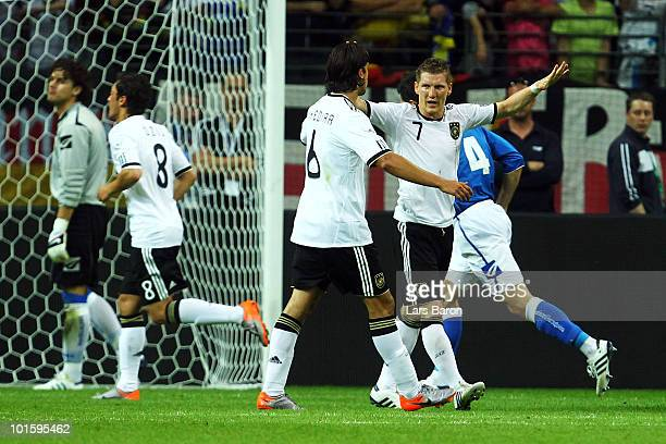 Bastian Schweinsteiger of Germany celebrates with team mate Sami Khedira after scoring his teams third goal during the international friendly match...