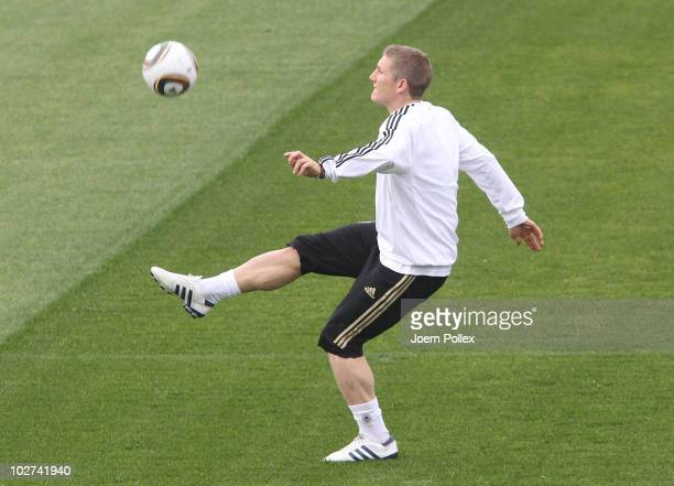 Bastian Schweinsteiger of Germany controls the ball during training session at Super stadium on July 9 2010 in Pretoria South Africa