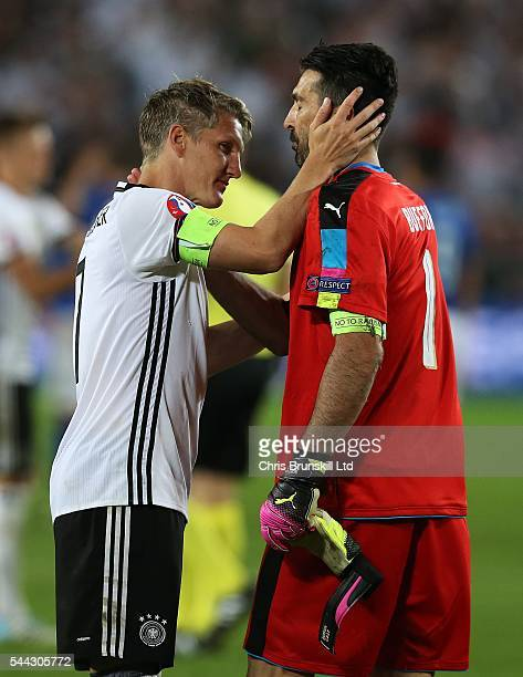 Bastian Schweinsteiger of Germany embraces Gianluigi Buffon of Italy at full-time following the UEFA Euro 2016 Quarter Final match between Germany...