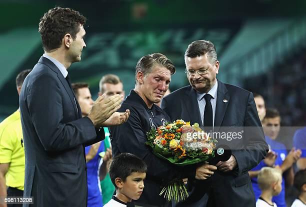 Bastian Schweinsteiger of Germany gets emotional with Reinhard Grindel DFB President prior to his last international match the International Friendly...