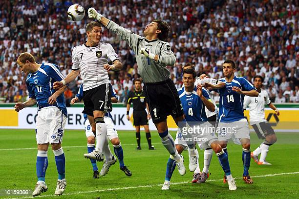 Bastian Schweinsteiger of Germany goes up for a header next to goalkeeper Kenan Hasagic of Bosnia during the international friendly match between...
