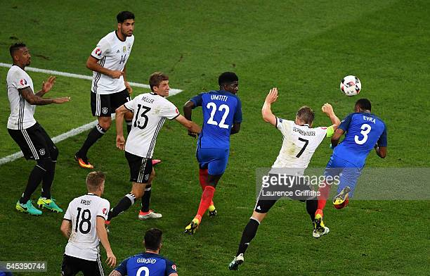 Bastian Schweinsteiger of Germany handles the ball off the head of Patrice Evra of France during the UEFA EURO semi final match between Germany and...